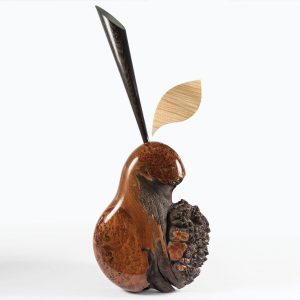 Wooden pear sculpture with floating leaf